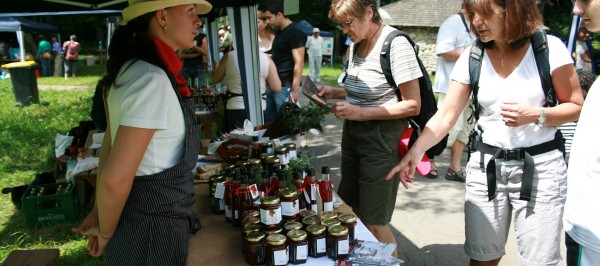 Farmer at a local market selling jams